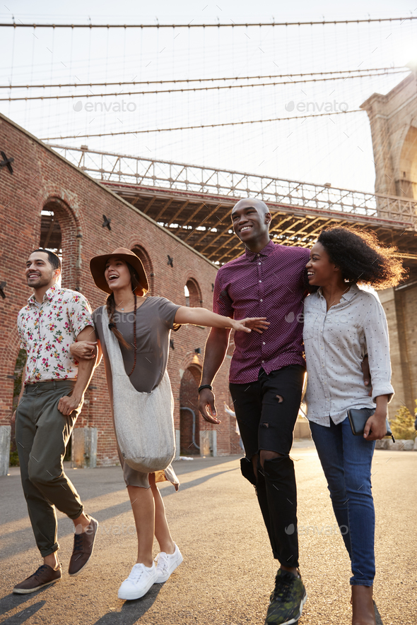 Group Of Friends Walking By Brooklyn Bridge In New York City - Stock Photo - Images