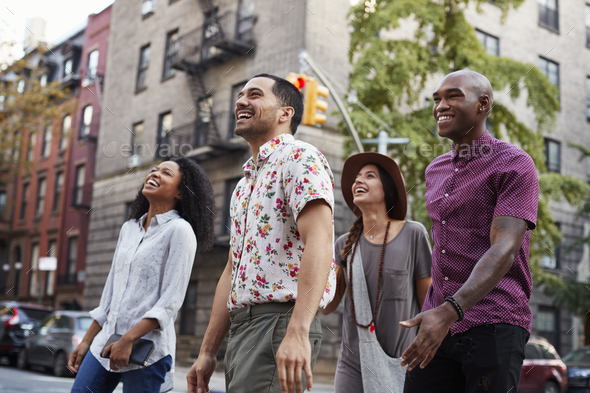 Group Of Friends Walking Along Urban Street In New York City - Stock Photo - Images
