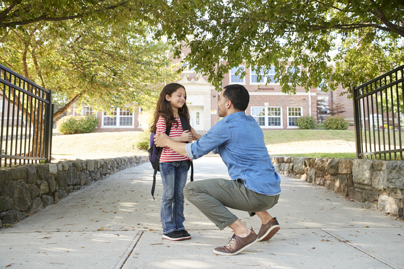 Father Dropping Off Daughter In Front Of School Gates - Stock Photo - Images