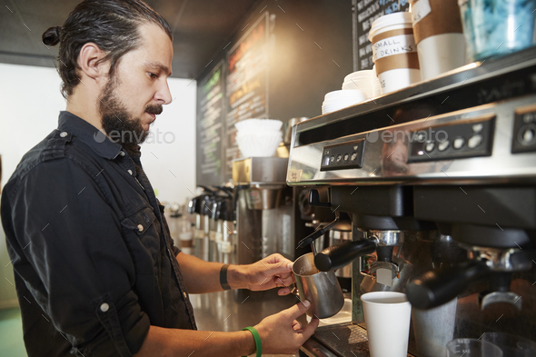 Male Barista Using Coffee Machine Behind Counter In Cafe - Stock Photo - Images
