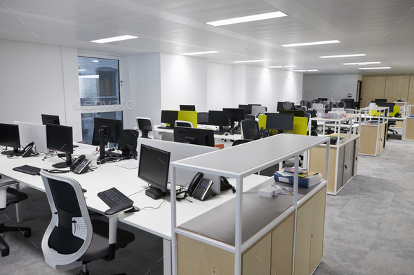 Empty open plan office with multiple work stations - Stock Photo - Images