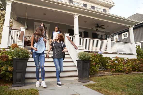 Young teen girlfriends leaving a house for school - Stock Photo - Images