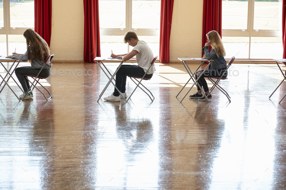 Group Of Teenage Students Sitting Examination In School Hall - Stock Photo - Images