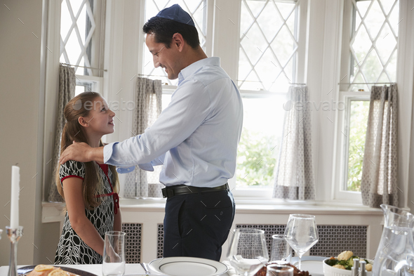 Jewish man standing with daughter before Shabbat meal - Stock Photo - Images