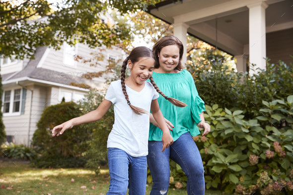 Grandmother Playing Soccer In Garden With Granddaughter - Stock Photo - Images