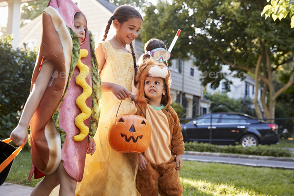 Children Wearing Halloween Costumes For Trick Or Treating - Stock Photo - Images