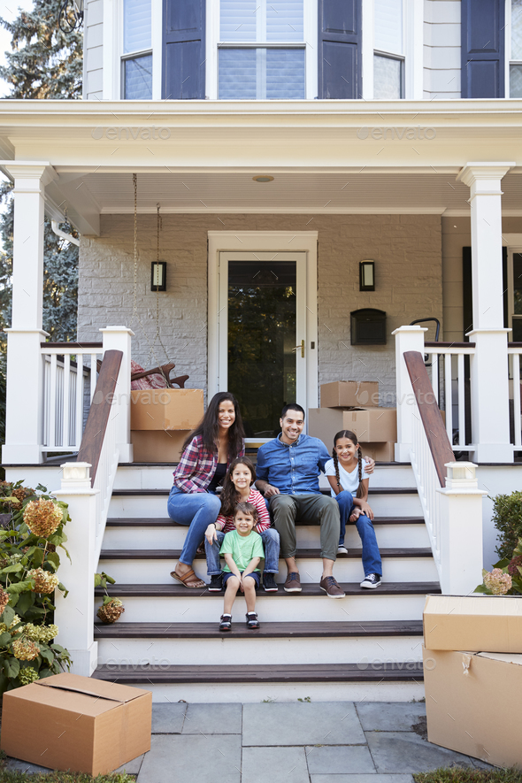 Family Sitting On Steps Of New Home On Moving In Day - Stock Photo - Images