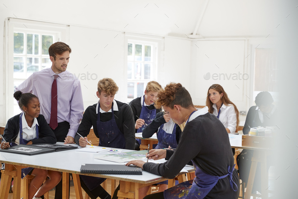 Teenage Students Listening To Teacher In Art Class - Stock Photo - Images