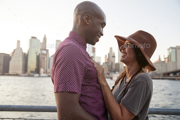 Romantic Young Couple With Manhattan Skyline In Background - Stock Photo - Images