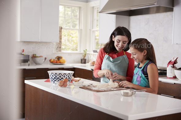 Jewish mother and daughter plaiting dough for challah bread - Stock Photo - Images