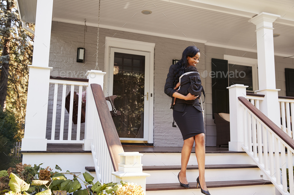 Businesswoman With Baby Son Leaving House For Work - Stock Photo - Images