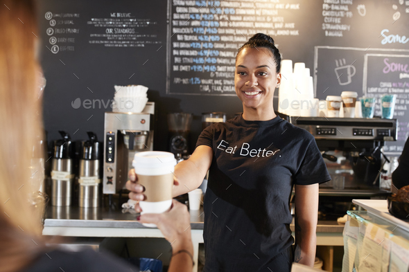 Female Barista Serving Customer With Takeaway Coffee In Cafe - Stock Photo - Images
