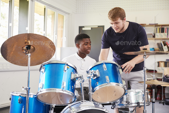 Male Pupil With Teacher Playing Drums In Music Lesson - Stock Photo - Images