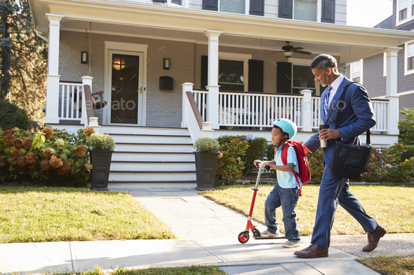 Businessman Father Walking Son On Scooter To School - Stock Photo - Images