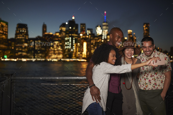 Group Of Friends Posing For Selfie In Front Of Manhattan Skyline - Stock Photo - Images