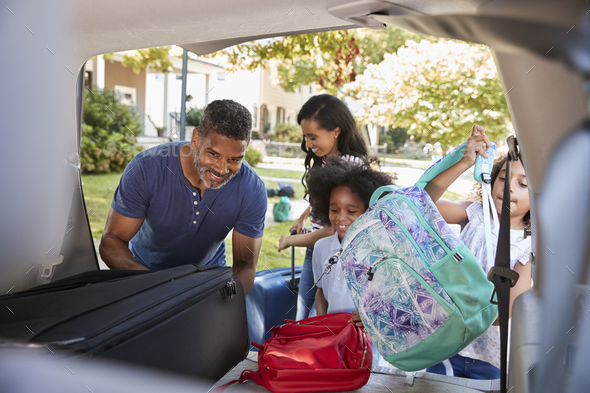 Family Leaving For Vacation Loading Luggage Into Car - Stock Photo - Images