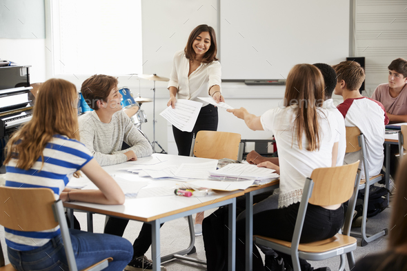 Teenage Students Studying In Music Class With Female Teacher - Stock Photo - Images
