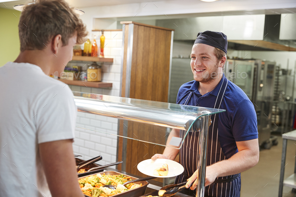 Teenage Students Being Served Meal In School Canteen - Stock Photo - Images