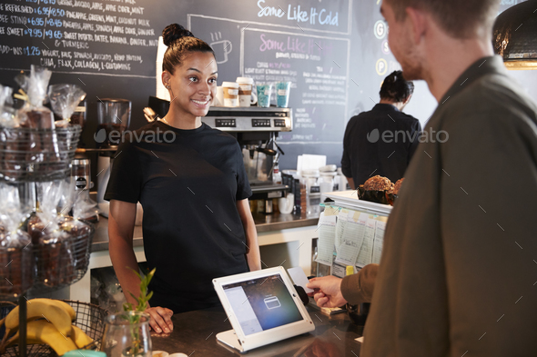 Customer Paying In Coffee Shop Using Credit Card - Stock Photo - Images