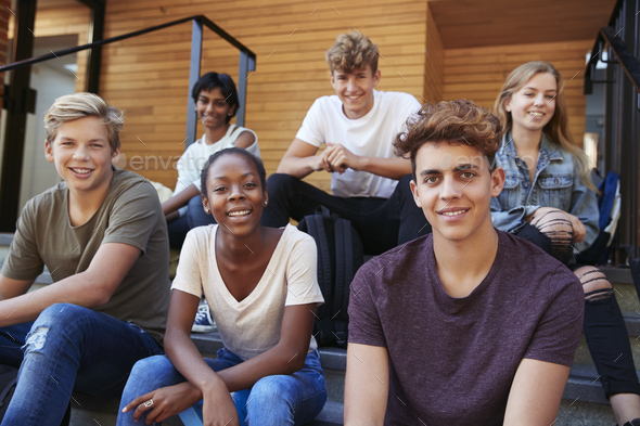 Group Of Teenage Students Socialising On College Campus Together - Stock Photo - Images