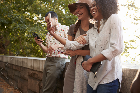 Group Of Tourists Taking Photos On Mobile Phones - Stock Photo - Images