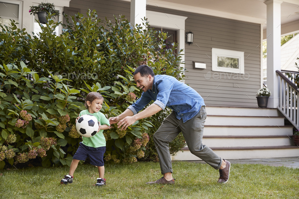 Father Playing Soccer In Garden With Son - Stock Photo - Images