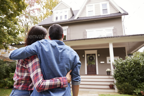 Rear View Of Loving Couple Looking At House - Stock Photo - Images