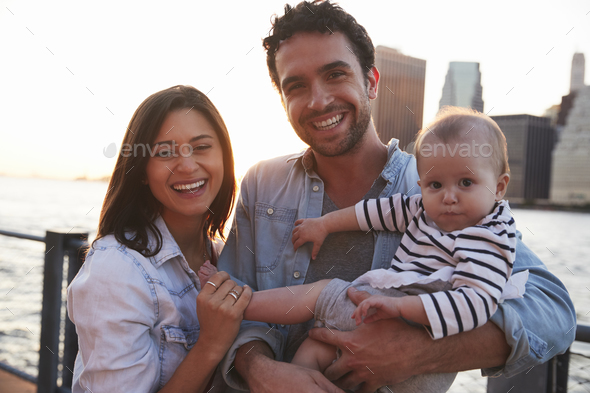 Young family with daughter standing on quayside, close up - Stock Photo - Images
