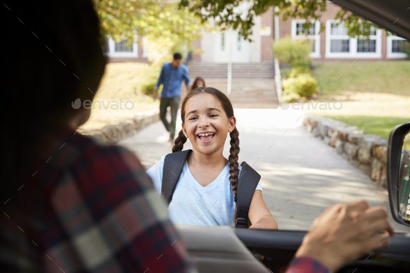 Mother In Car Collecting Daughter In Front Of School Gates - Stock Photo - Images