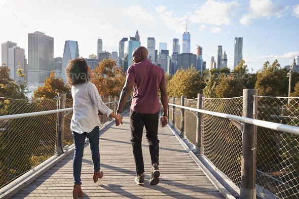 Couple Visiting New York With Manhattan Skyline In Background - Stock Photo - Images