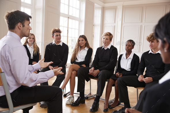 Group Of Teenage Students Having Discussion With Tutor - Stock Photo - Images