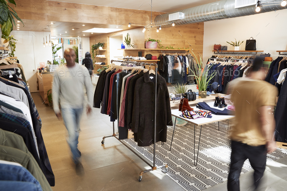 People walking through a busy clothes shop, motion blur - Stock Photo - Images