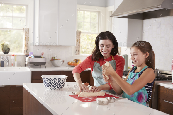 Jewish mother and daughter preparing dough for challah bread - Stock Photo - Images