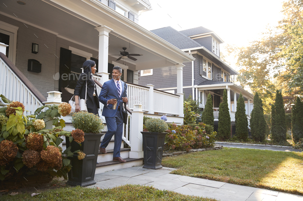 Business Couple Leaving Suburban House For Commute To Work - Stock Photo - Images