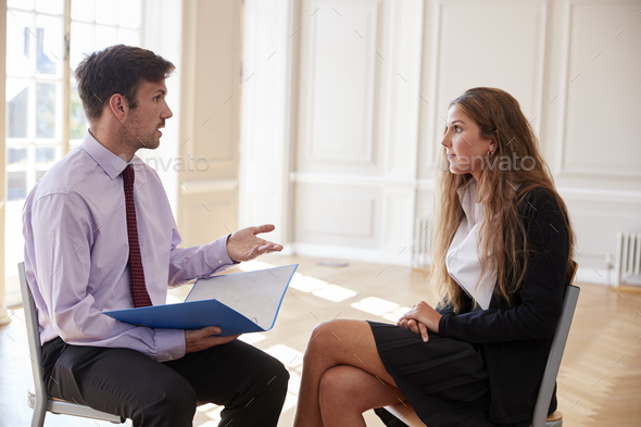 Female Teenage Student Having Discussion With Tutor - Stock Photo - Images