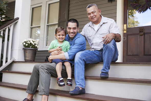 Male Multi Generation Family Sitting On Steps in Front Of House - Stock Photo - Images