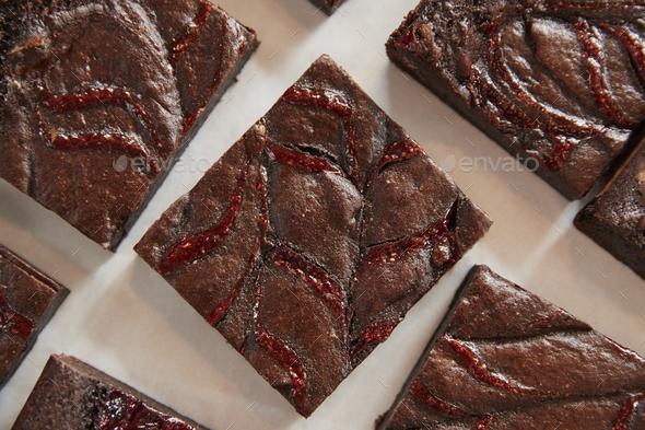 Display Of Freshly Baked Raspberry Swirl Brownies In Coffee Shop - Stock Photo - Images