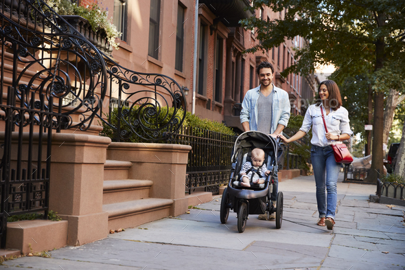 Family taking a walk down the street, close up - Stock Photo - Images