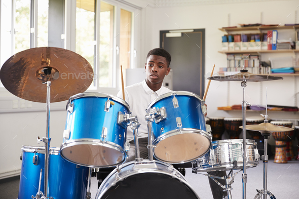Male Teenage Pupil Playing Drums In Music Lesson - Stock Photo - Images