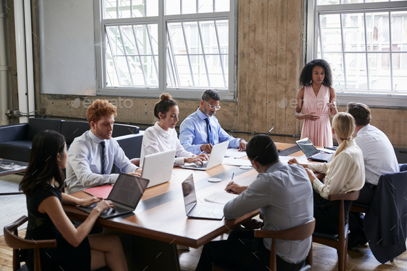 Black businesswoman addressing colleagues at a board meeting - Stock Photo - Images