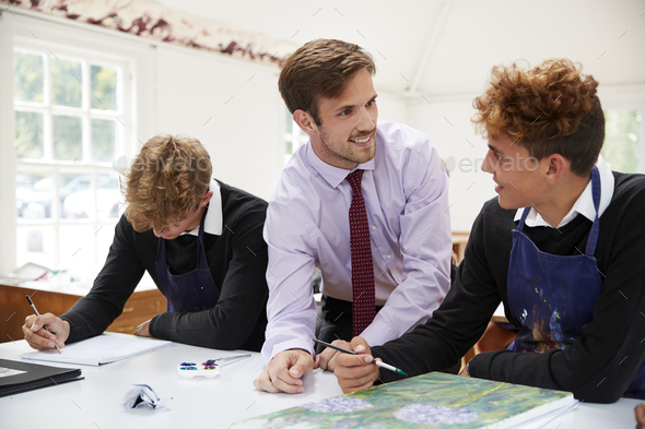 Male Teacher Helping Teenage Pupils In Art Class - Stock Photo - Images