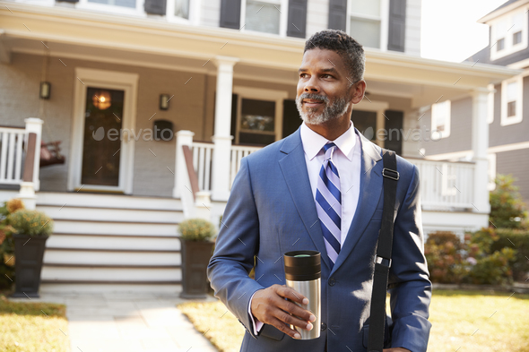 Businessman With Cup Of Coffee Leaving Suburban House For Work - Stock Photo - Images