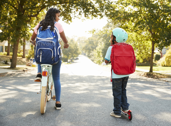 Sister With Brother Riding Scooter And Bike To School - Stock Photo - Images