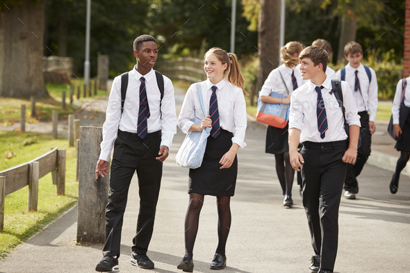 Group Of Teenage Students In Uniform Outside School Buildings - Stock Photo - Images