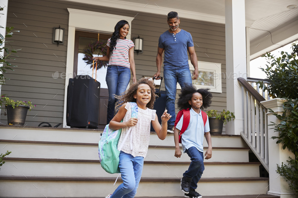 Family With Luggage Leaving House For Vacation - Stock Photo - Images