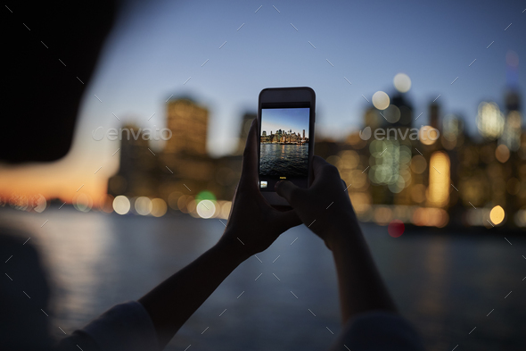 Silhouette Of Tourist Taking Photo Of Manhattan Skyline At Dusk - Stock Photo - Images
