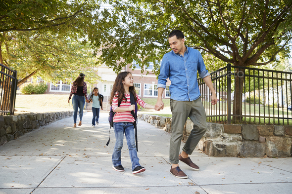 Father In Collecting Daughter At The End Of School - Stock Photo - Images