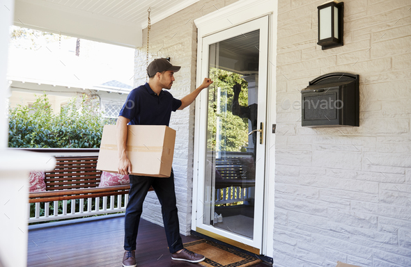 Courier Knocking On Door Of House To Deliver Package - Stock Photo - Images