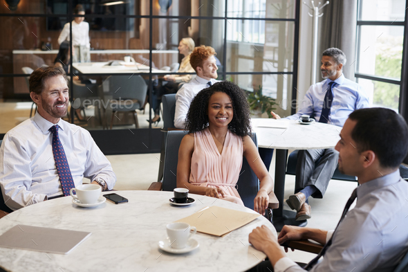 Three work colleagues talking at their office cafe - Stock Photo - Images