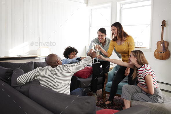 Five young friends at home making a toast,cheers, close up - Stock Photo - Images